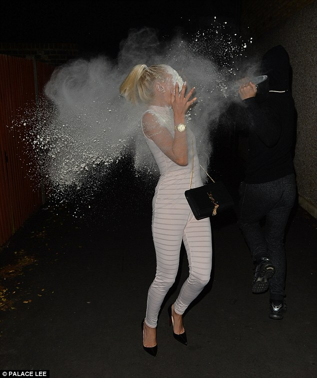 In shock: The beauty recoiled in horror as she was thrown the powder face on