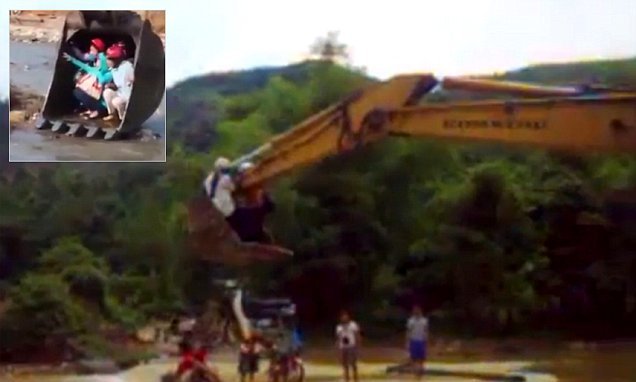 Group of Vietnamese teachers are lifted over a river by an EXCAVATOR