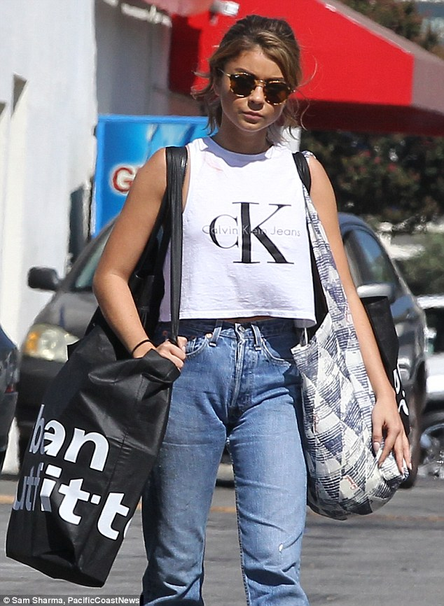 Gone shopping: Sarah Hyland treated herself to some retail therapy in LA on Friday and was seen leaving Urban Outfitters carrying two large bags