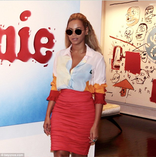 Red hot! Beyoncé showed off her enviable figure in a skintight, high-waisted red skirt and coordinating blouse