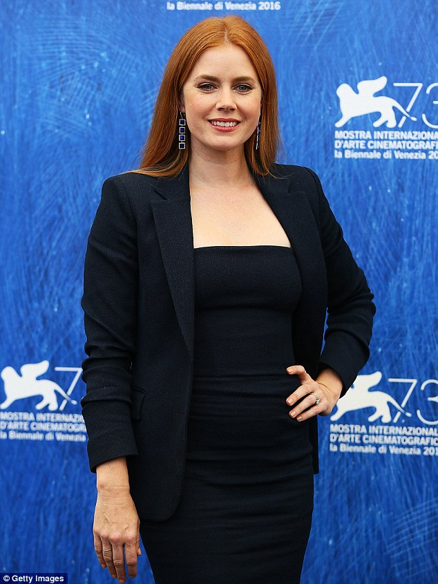Stunning: The 42-year-old screen star teamed a figure-hugging dress with a matching blazer
