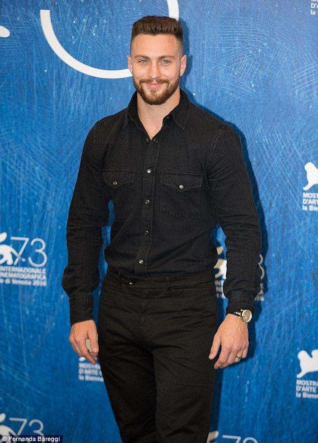 Hair today...: He also sported a fashionable beard as he posed for photographers at the event