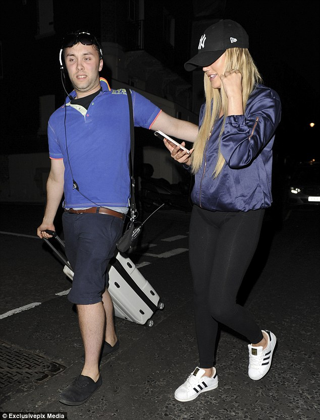 Sporty style: The reality show favourite covered up in a blue satin jacket, teamed with leggings and trainers