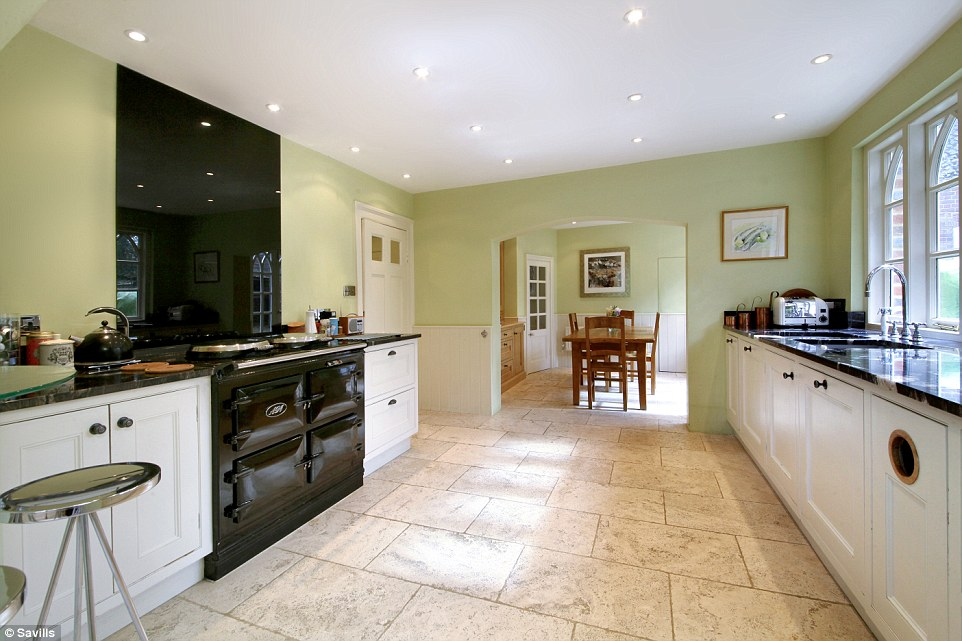 The Bake Off star is believed to have filmed much of her early TV work in the property's spacious kitchen, which features an electric Aga and country style white wooden furniture
