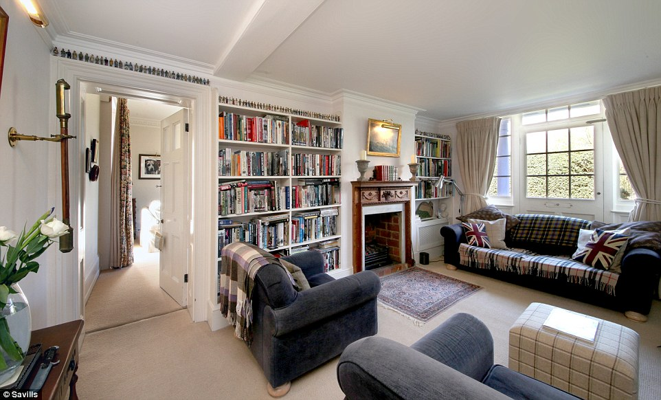 Throughout the property, high ceilings and large windows create a bright and spacious feel in the and original features including fire places and ornate cornicing add plenty of character. Pictured, the snug