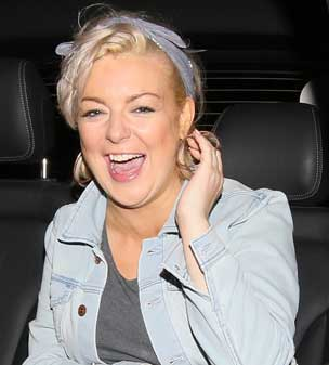 Giggling with glee: Sheridan Smith was on top form as she left the Savoy theatre in London.