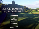This undated photo provided by Jekyll Island Authority shows a sign warning golfers to ¿Be Aware¿ of alligators on Jekyll Island, Georgia. The state park recently placed roughly 30 signs at golf course entrances, ponds and ditches to make sure visitors know the island is home to an abundance of alligators.  (Ben Carswell/Jekyll Island Authority via AP)