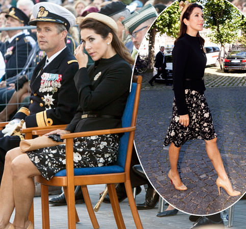 Princess Mary dabs her eyes as she attends solemn memorial service