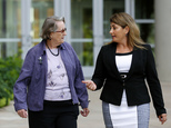 In this Aug. 11, 2016 photo, Angela McArthur, left, director of the Anatomy Bequest Program at the University of Minnesota Medical School, walks with Jean Larson, widow of a donor in Minneapolis. Once a relatively rare option, body donation has surged at medical schools, including the University of Minnesota. The increase has helped provide cadavers for dissection by first-year medical students, and for research and surgical training. (AP Photo/Andy Clayton-King)