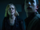 """FILE - This undated file image released by Sony Pictures shows Jane Levy, left, and Dylan Minnette in a scene from """"Dont Breathe."""" The horror thriller ¿Don¿t Breathe¿ topped the box office for the second straight week, while a several new releases struggled to find any traction over the 2016 Labor Day weekend. (Gordon Timpen/Sony/Screen Gems via AP, File)"""