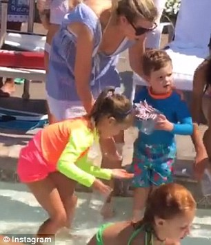 Getting in: Ivanka Trump shared a video of herself and her son Joseph, two, catching fish in a pool on Sunday