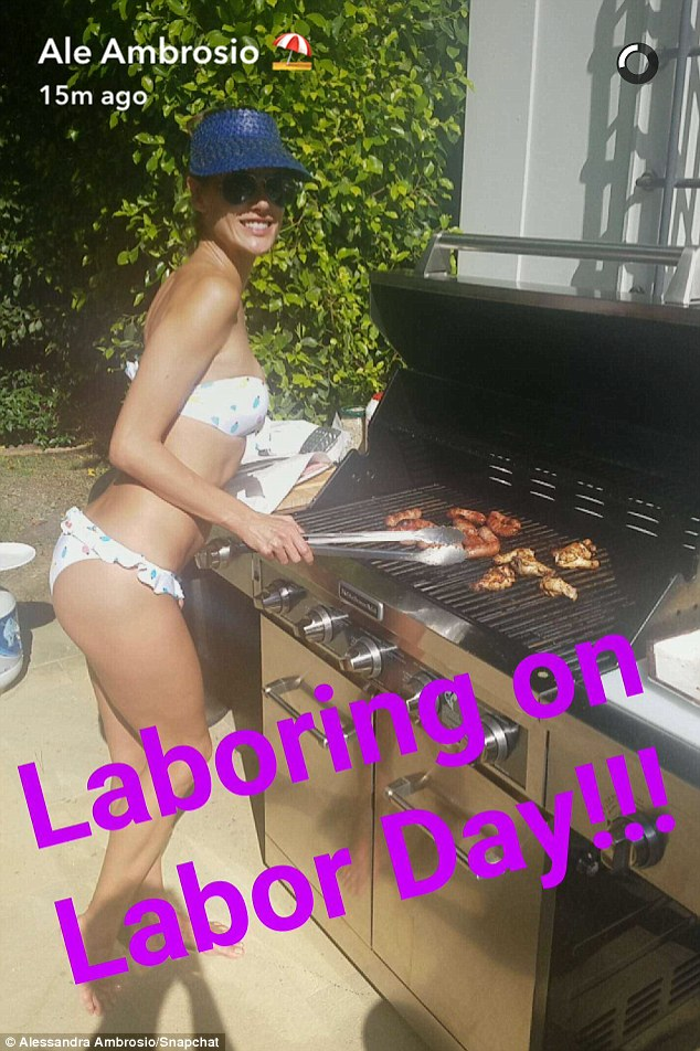 What's cooking, good looking? The stunner also was seen grilling some meat on the barbecue for the Labor Day holiday