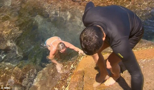 Doh: And she ended up falling back into the water after slipping on the rocks
