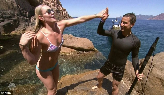 High fives: The odd couple celebrated their latest survival triumph
