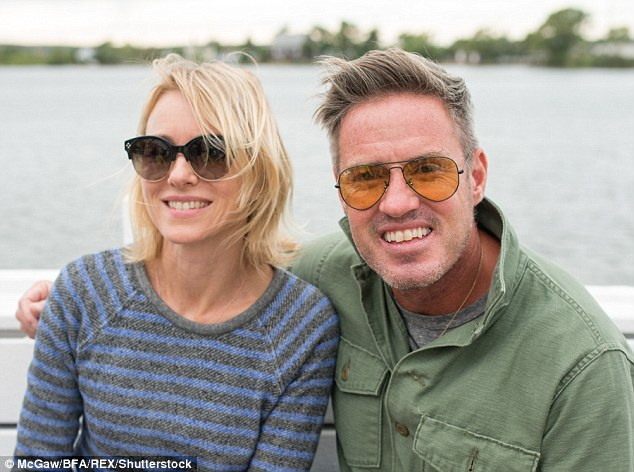 Catching up: The pair were spotted as they sat arm-in-arm at the swanky event, which was sponsored by Ray Ban, with the spectacular view of the water behind them