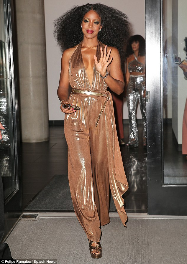 Golden girl: Kelly Rowland was clearly keen to make the effort for close friend Beyonce's Soul-Train-themed 35th birthday bash in New York City on Monday night