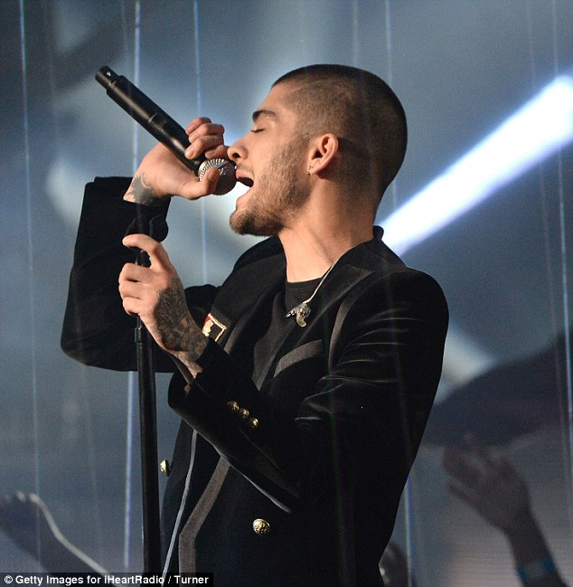 Belting it out:Zayn Malik has been forced to pull out of a gig in Dubai next month due to his ongoing anxiety surrounding solo performances, it was revealed on Tuesday
