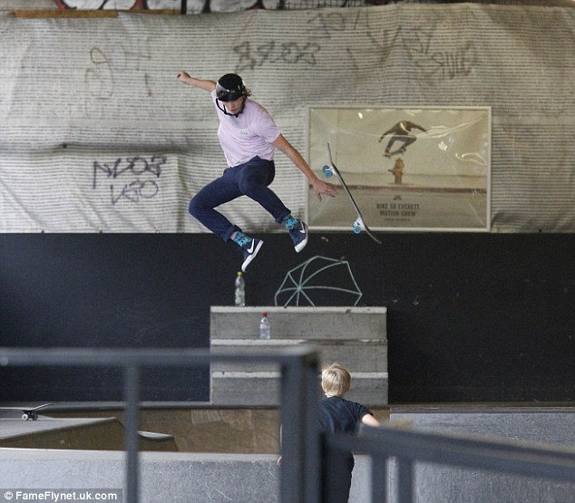 In the air: Brooklyn showed off his sporting skills at the indoor arena