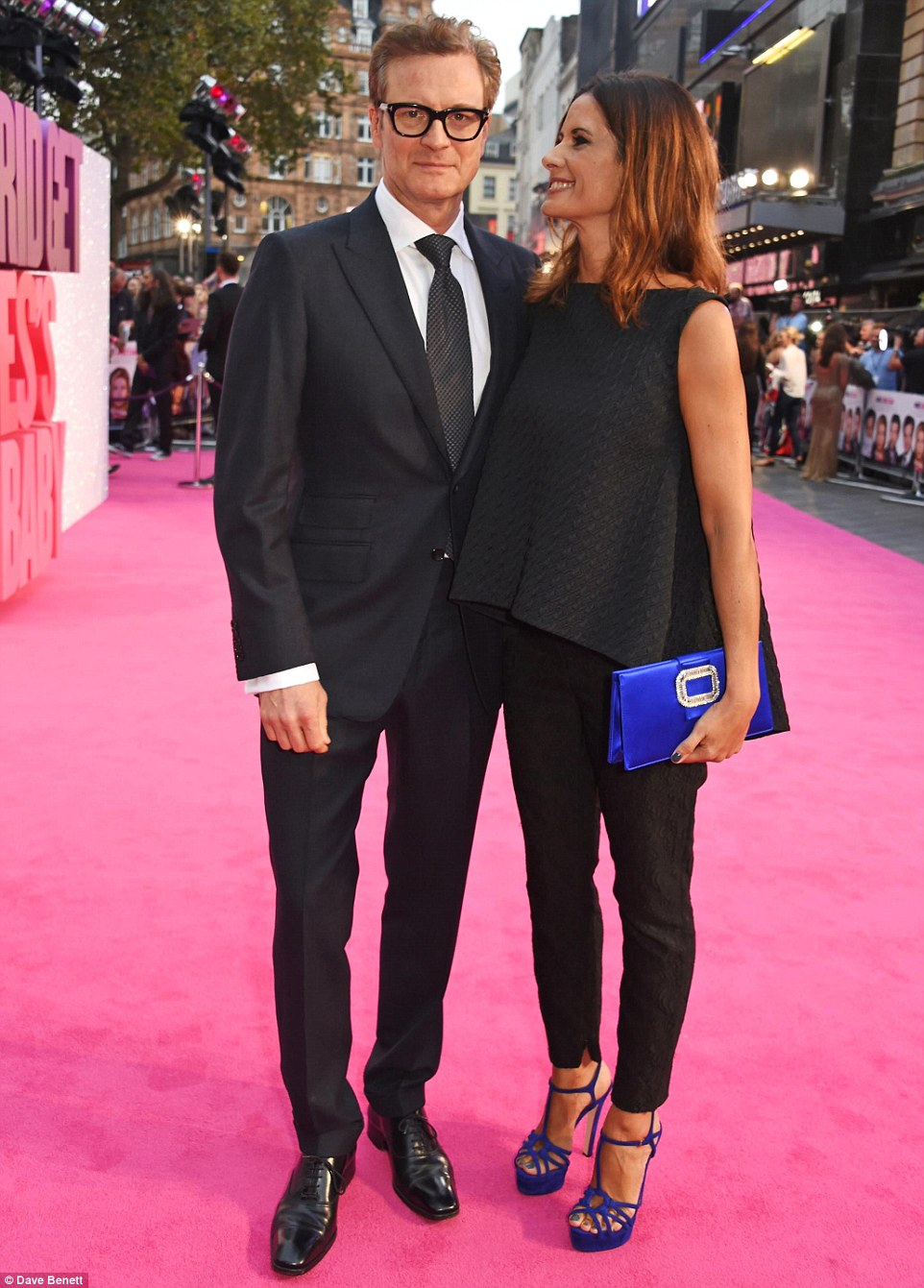 The look of love: Livia gazed adoringly at her husband Colin Firth as they made their way across the pink carpet