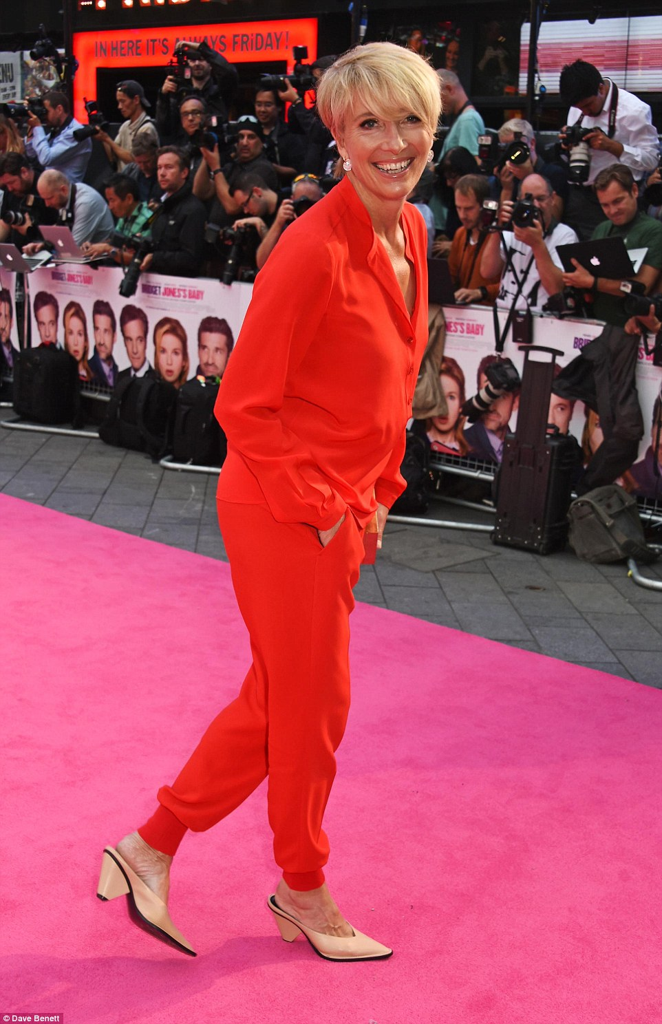 Lady in red: Emma Thompson rocked a slightly off the wall but stylish look in a red trouser suit and nude heels
