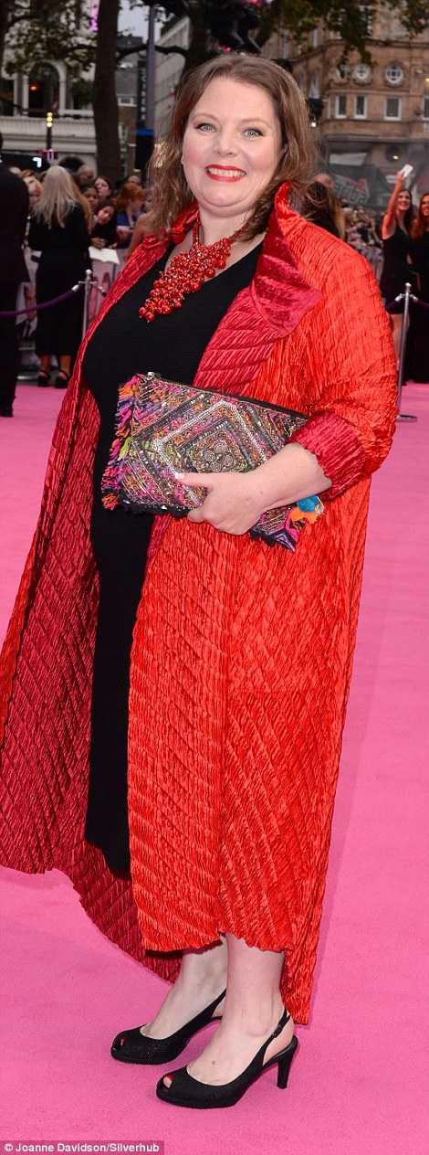 In the thick of it: Joanna Scanlan wore a black dress and red quilted coat to the event