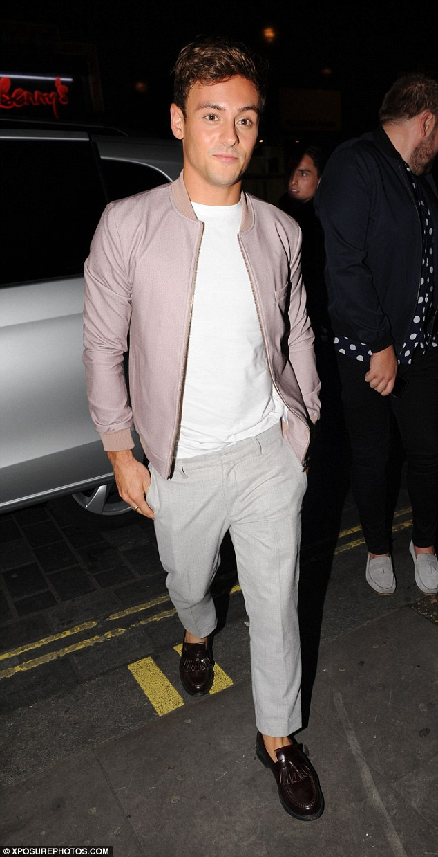 Going for gold... Olympian Tom Daley looked smart in a pastel coloured ensemble