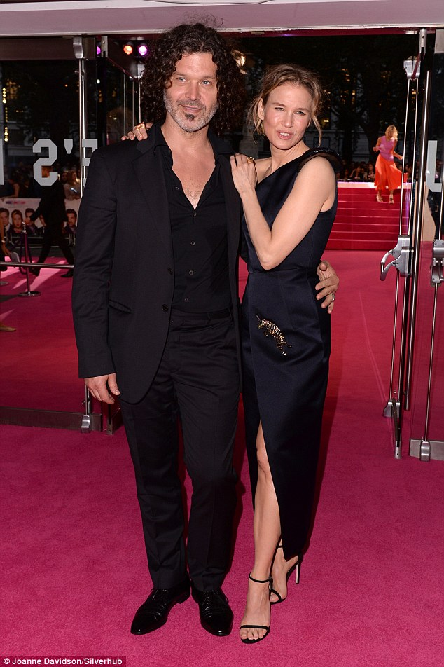 Loved-up:Renée  looked happier than ever with her boyfriend who she cosied up to at the Bridget Jones's Baby premiere on Monday night