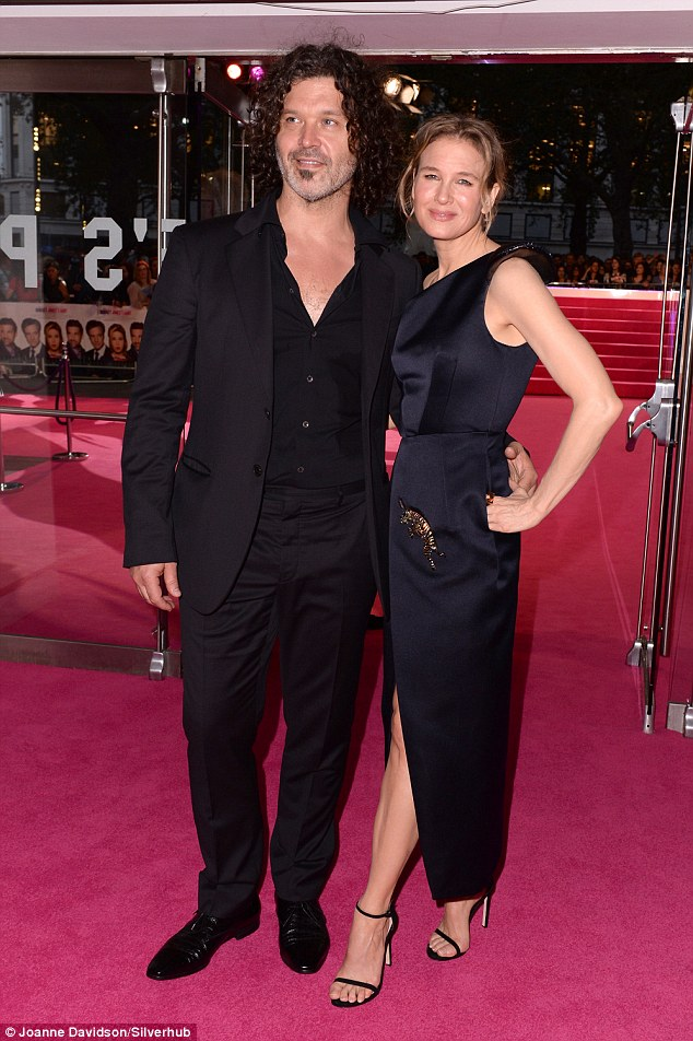 Monchrome maven: Renée stunned in a one-shoulder satin dress as she posed for photos shortly after making her way onto the appropriately pink carpet