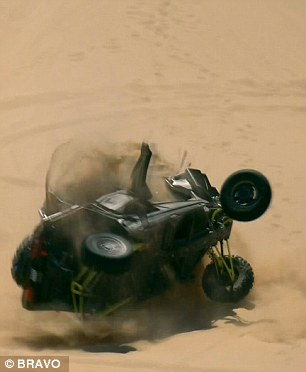 In trouble: At the top of the dune, the quad flipped over - with cameras showing the horror inside the vehicle as the women took the full impact of the crash