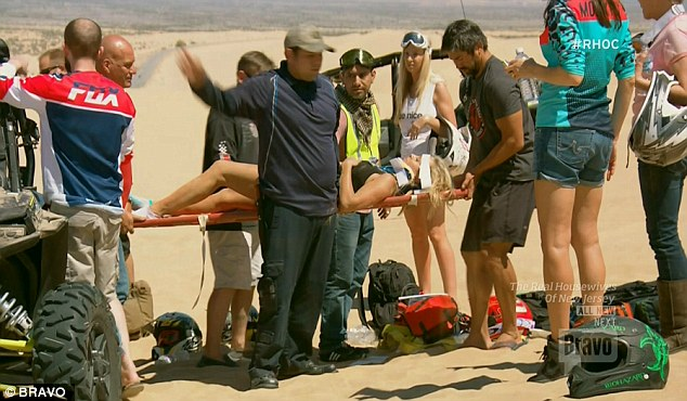 Hurt: ¿Tamra¿s down,¿ a voice was heard saying as the camera showed her out of the vehicle and laid out on her back, clearly badly hurt and with her horrified mother Sandy looking on helplessly