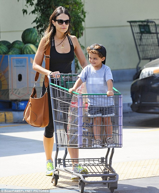What a ride! Jordana Brewster's son gave a cheeky grin while his mum, 36, pushed him in a grocery cart