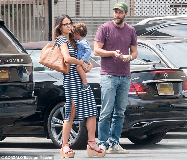Family outing: Jordana is pictured with  husband Andrew Form and son Julian earlier this week