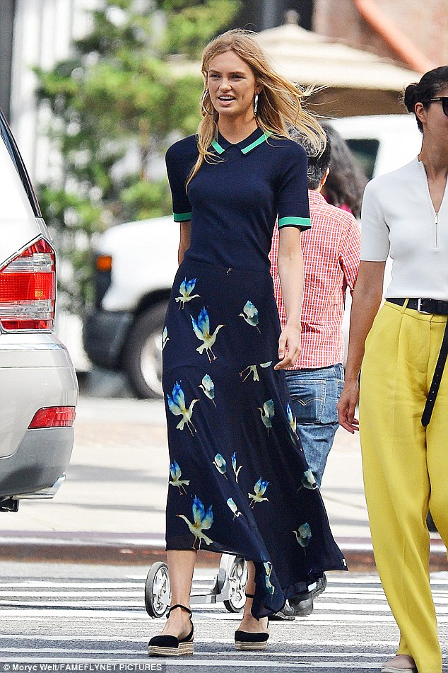 Head-turner: Romee Strijd was spotted in a long, chiffon statement skirt in New York City on Monday as she put her long and lean figure on display