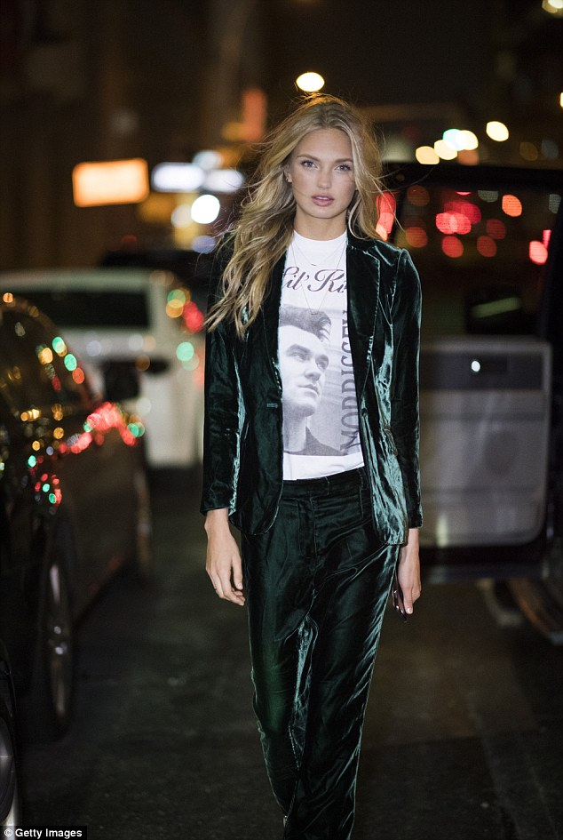 Stunner: Romee gazed into the camera as she strutted down the road