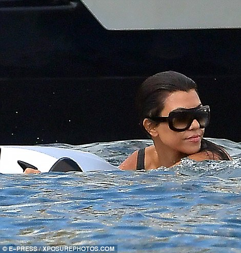 Always stylish: Kourtney kept her oversized sunglasses on as they frolicked in the water
