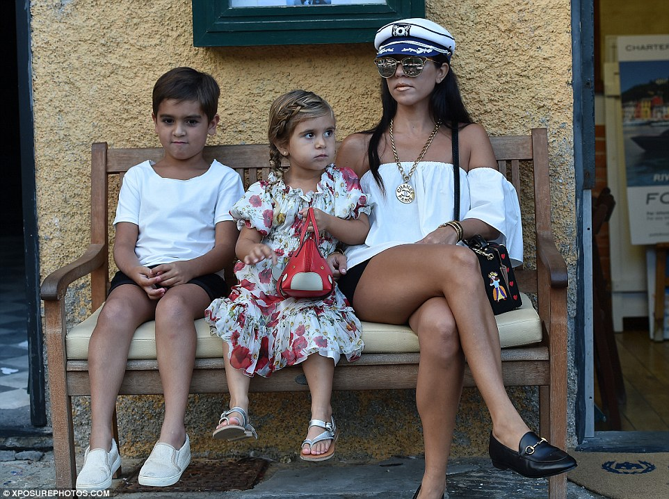 Relaxing: Kourtney and the kids stopped for a breather as they visited the scenic spot