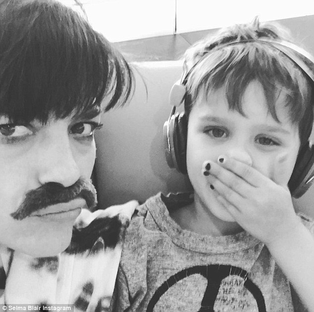 Doting mother: The brunette star recently wrapped her thriller film, Mom and Dad, last week alongside Nicolas Cage; here she is pictured with five-year-old son Arthur