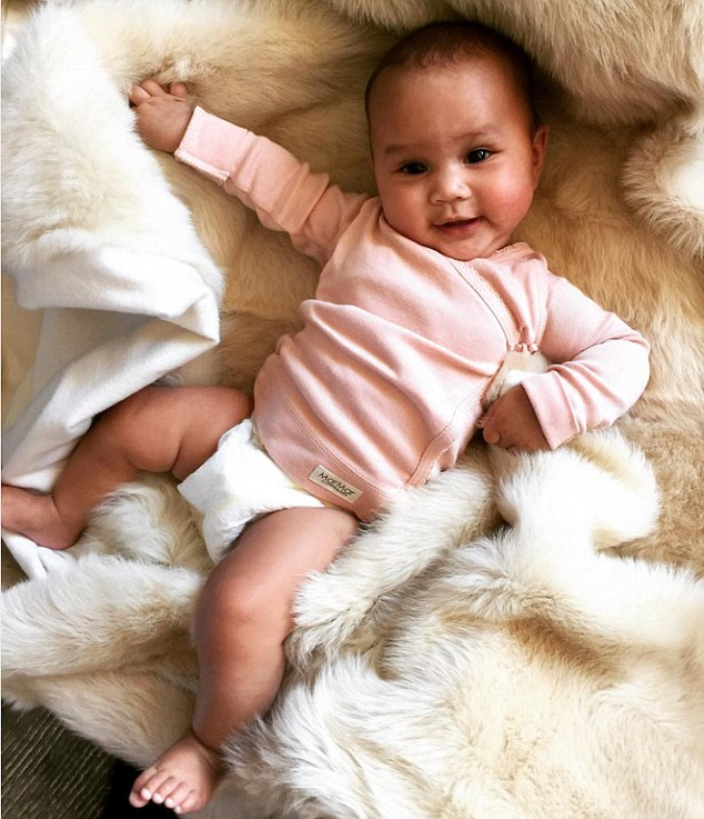 Pretty in pink: On Monday, Chrissy shared a very similar shot of her darling five-month-old daughter in a wrap-over cardigan