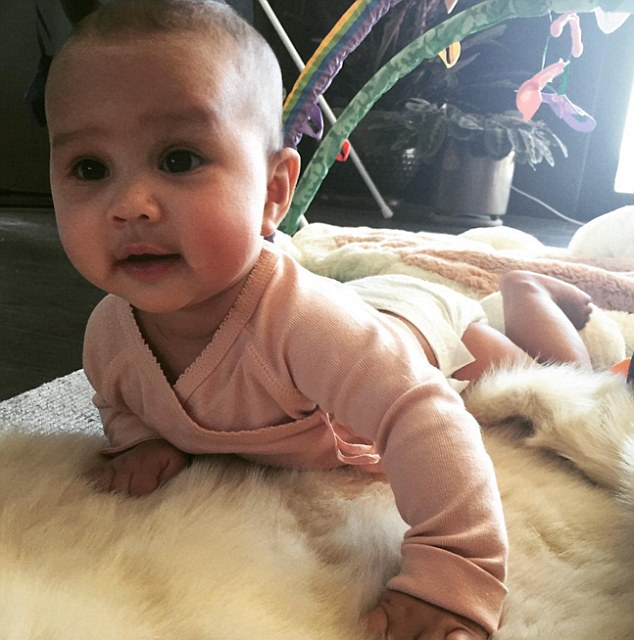 On the flip side: The 30-year-old also shared a snap of her little girl on her tummy on the blanket, pressing herself up on her arms and looking as if she's getting ready to start crawling