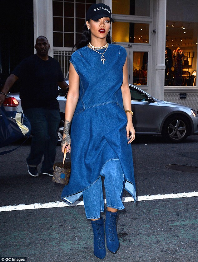 Commanding attention! Rihanna, 28, modeled a full-on denim look while out in New York City on Labor Day