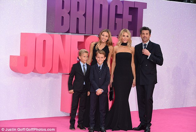 Stylish: His adorable sons looked pleased to be posing on the bright fuschia carpet, and seemed to take after their dad in the style department, rocking a gingham shirt and spotted ties