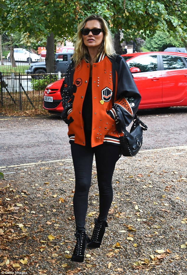 Rock chick: Kate Moss looked happy and relaxed as she was spotted running errands in North London wearing a varsity jacket by Coach