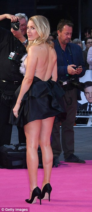 Leggy: Ellie showed off her long toned legs and wore black satin killer heels
