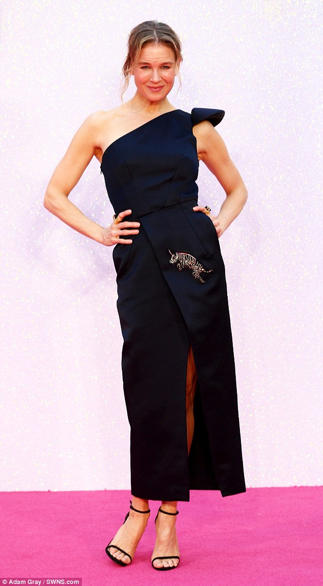 Chic: Accessorizing with a stylish brooch and delicate sandals, the 47-year-old actress wore her hair in a simple up-do