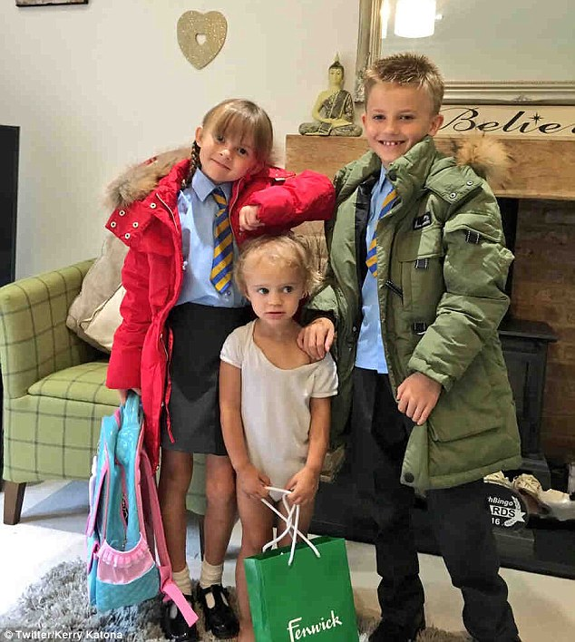 Cute: The trio of cuties also posed with the coats on as they prepared to head out into the September drizzle