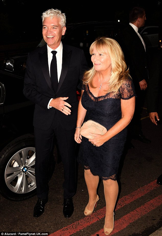 Night of glory: Phillip arrived at The Dorchester for Monday's ceremony accompanied by wife Stephanie