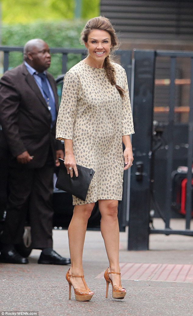 Glamorous: She arrived in a cute animal print dress that cut off at the knees