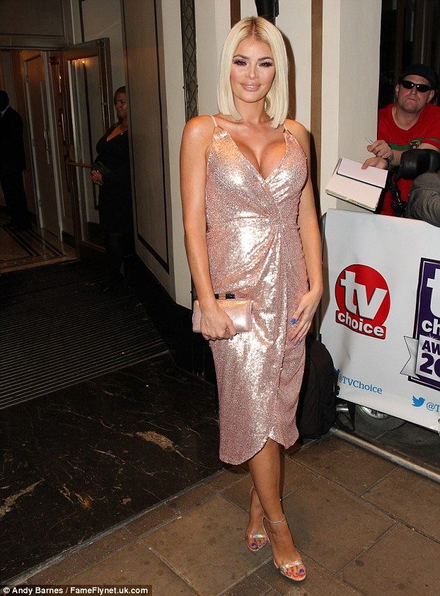 Perilously plunging:Pouting and smiling for the cameras, the blonde beauty seemed unfazed by her skimpy attire