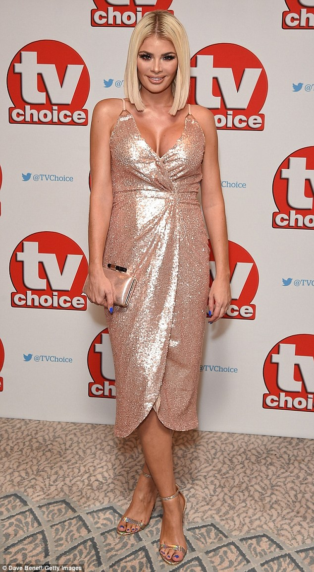 Easy does it:Chloe turned heads in her all-over sequinned dress, featuring a jaw-dropping V-neckline