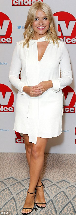 Parading those pins: Opting for a long-sleeved mini dress, Holly ensured her tanned and toned legs were firmly on display